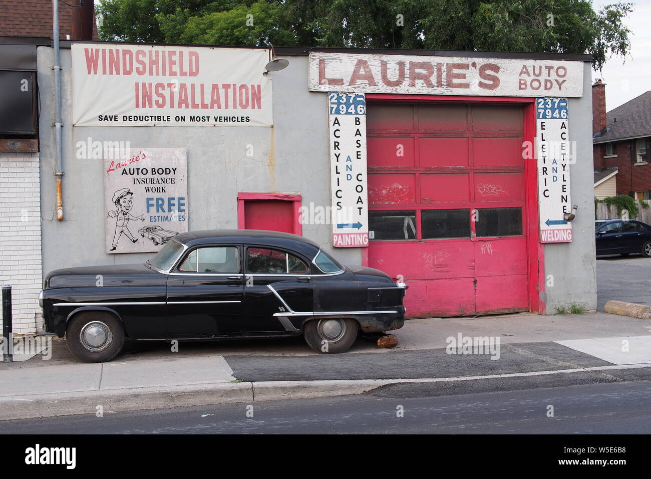 Vintage American Car Parked In Front Of Laurie S Auto Body Bronson Street Ottawa Ontario Canada Stock Photo Alamy