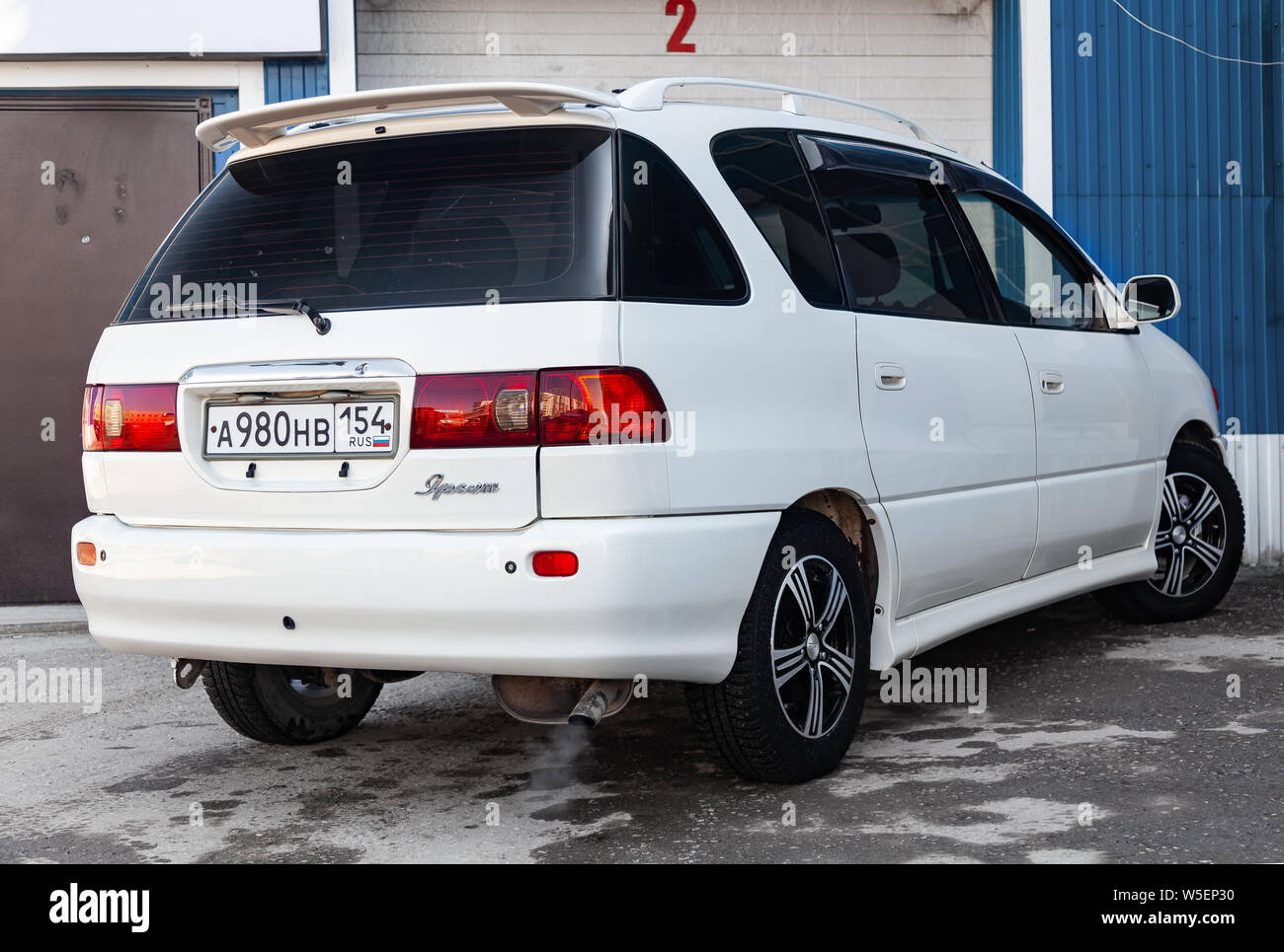 Novosibirsk, Russia - 07.25.2019: Rear view of Toyota Ipsum 1998 year in white color after cleaning before sale on parking Stock Photo