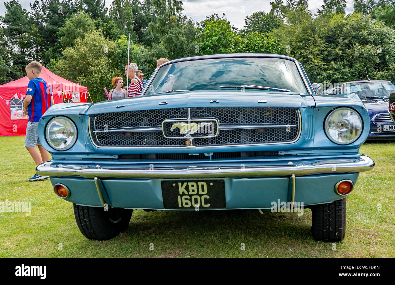 Front view of a blue vintage Ford Mustang on display at the annual classic car show in Wroxham, Norfolk, UK Stock Photo