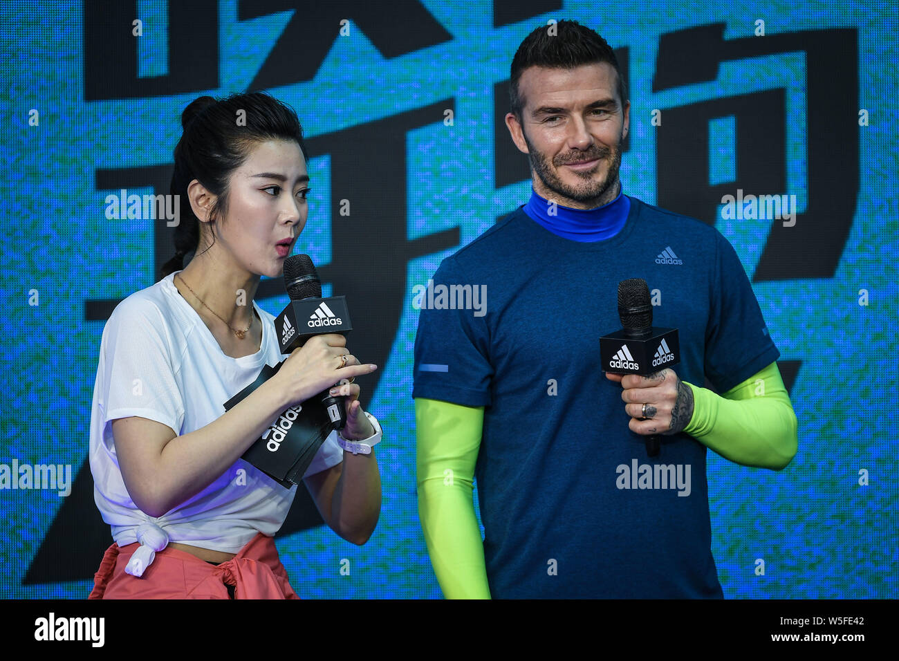 candidato Adoración Usando una computadora  English football star David Beckham, right, attends the launch event for  new products of adidas Originals x David Beckham in Guangzhou city, south  Chi Stock Photo - Alamy
