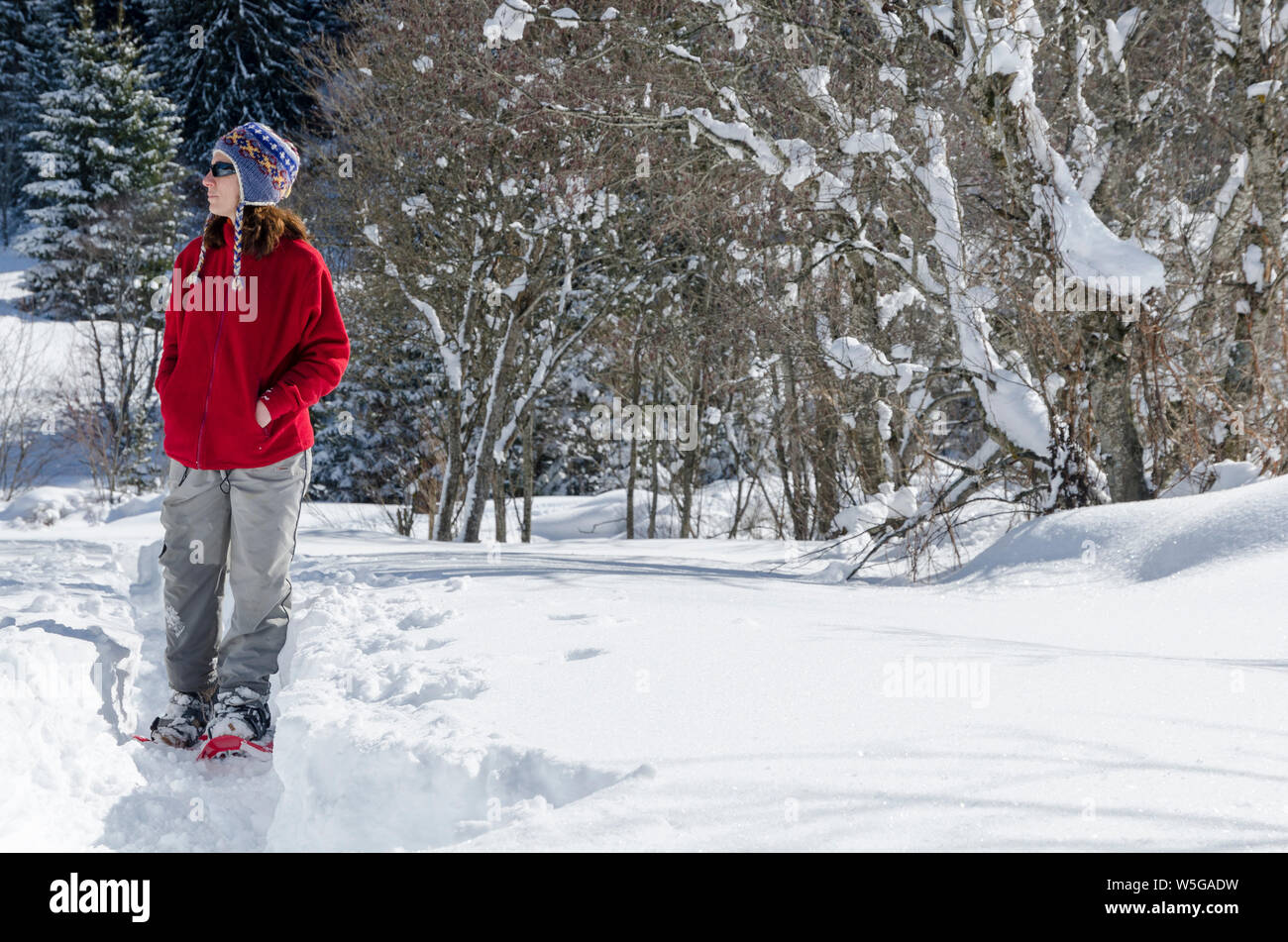 Italy, Lombardy, Retiche Alps, Camonica Valley, snowshoeing on the trail to the ancient alpine church of San Clemente Stock Photo