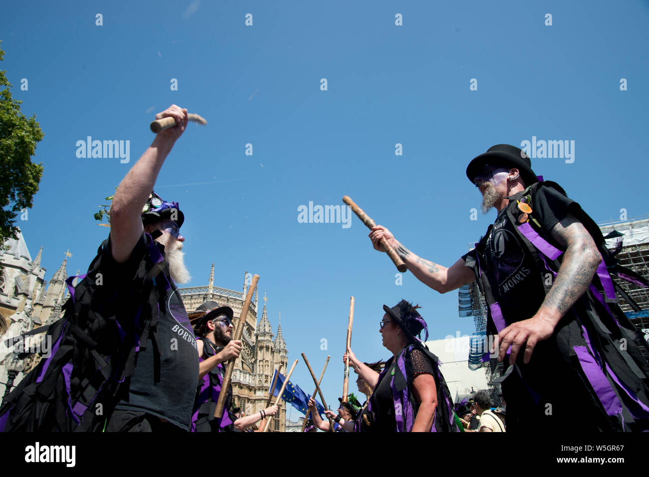 July 23rd 2019. Houses of Parliament. Morris dancers protest at May 4th 2020 being designated VE day celebration instead of being the May Day holiday. Stock Photo