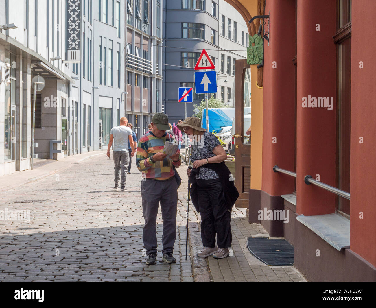 Active seniors discovering the city with a map, Riga, Latvia, Baltic States, EU. Stock Photo