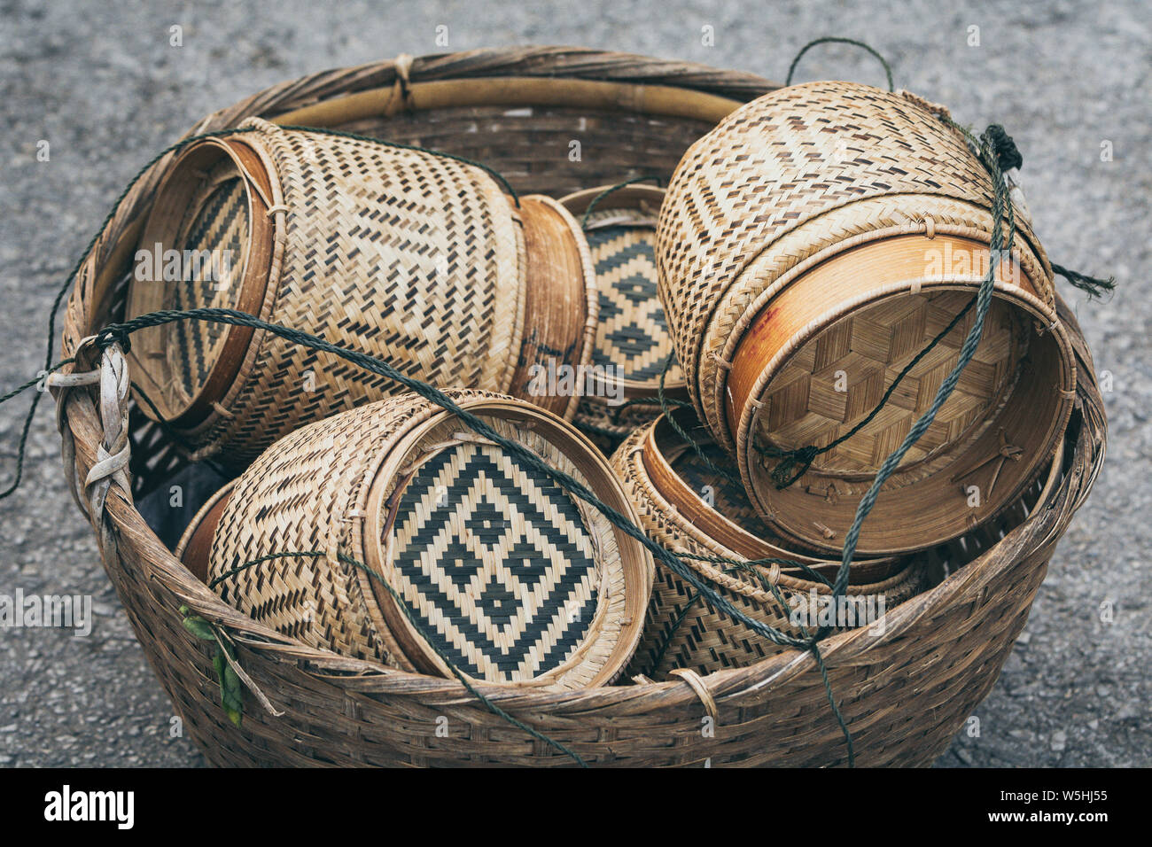 Traditional Laotian decorated rice baskets used for sacred Buddhist alms giving ceremony in Luang Prabang city, Laos. Stock Photo