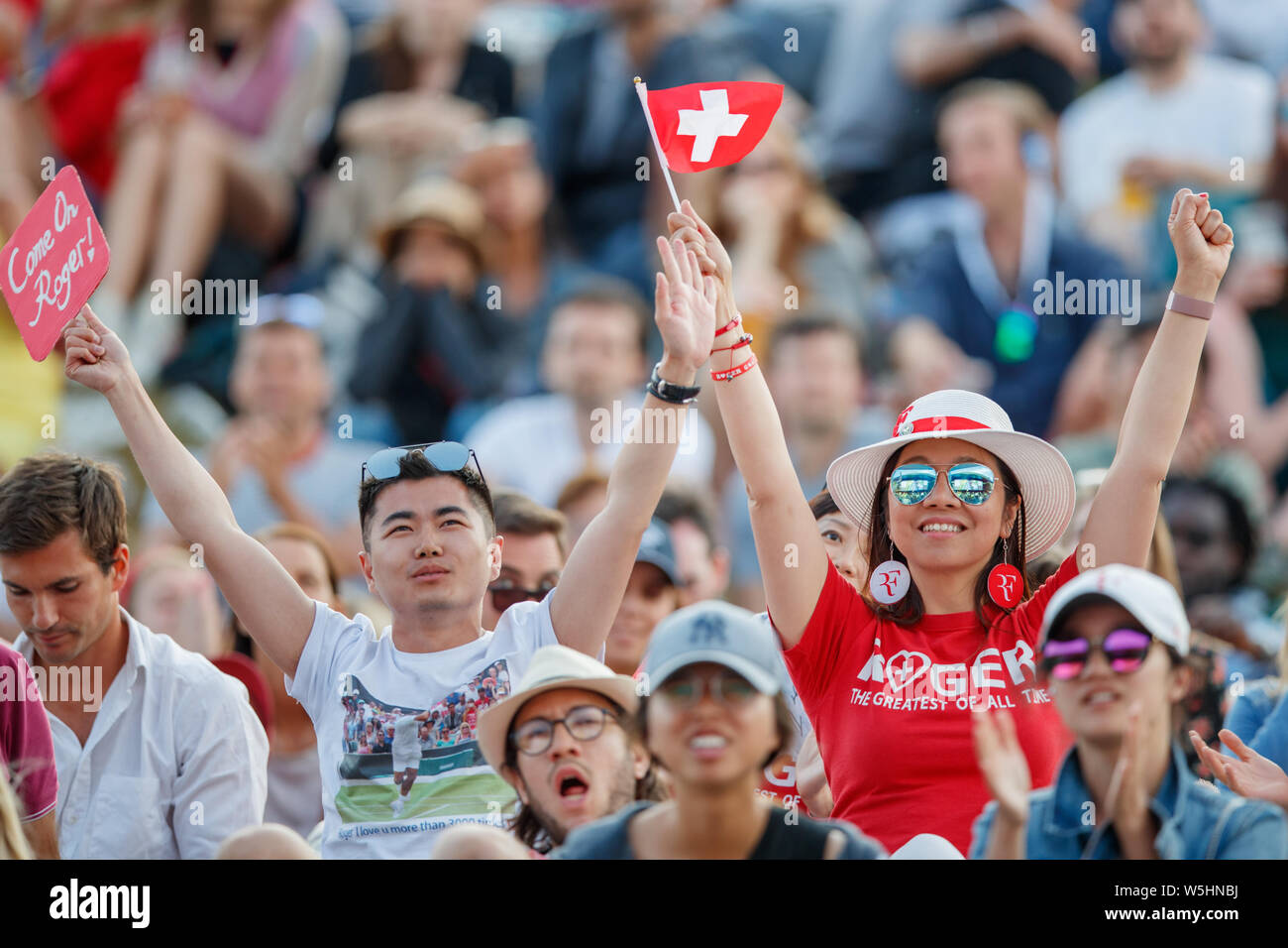 Roger Federer fans and spectators on Henman Hill Murray Mound or Aorangi Hill during The Championships at Wimbledon 2019. Stock Photo