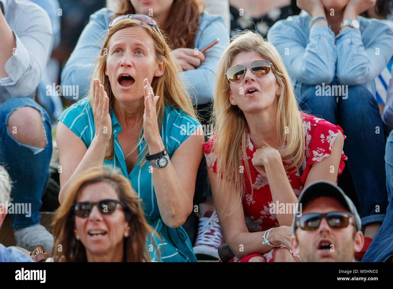 Spectators on Henman Hill Murray Mound or Aorangi Hill during The Championships at Wimbledon 2019. Stock Photo