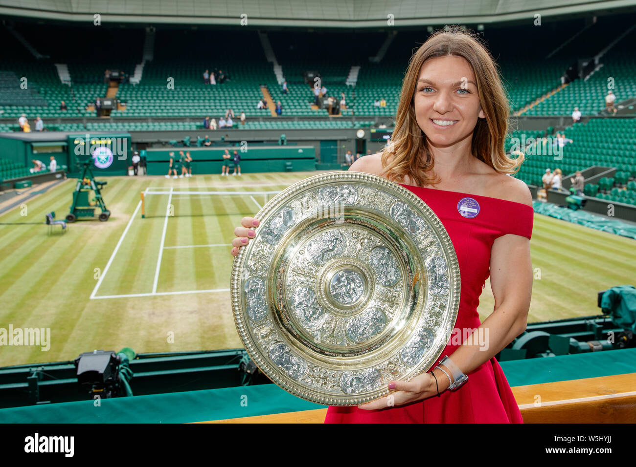 Simona Halep (ROU) with the 2019 Wimbledon Ladies' Singles Trophy on Centre Court at The All England Lawn Tennis Club, Wimbledon. Stock Photo