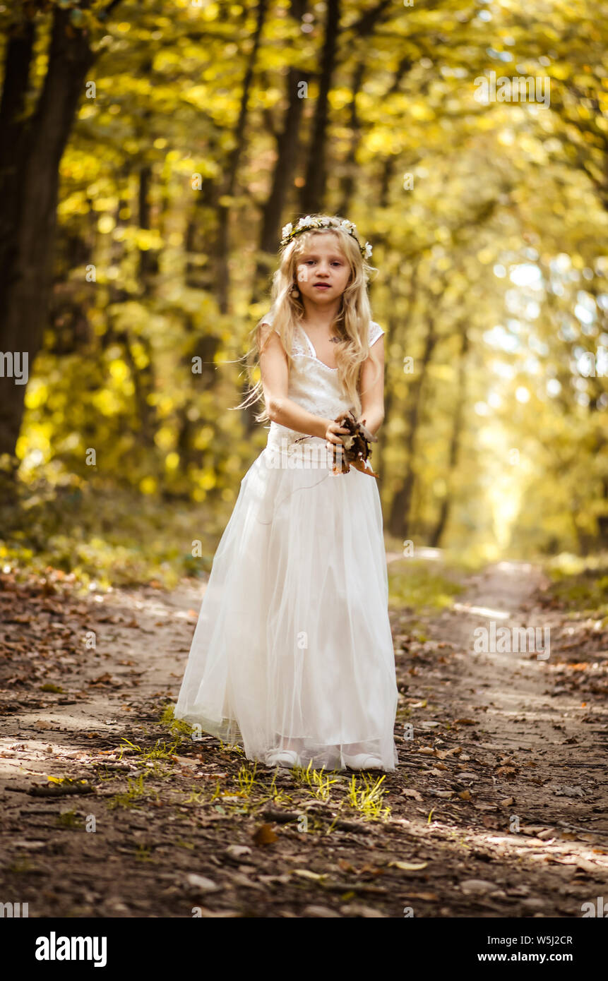 Cute Little Girl In Long White Wedding Dress Posing In Rural Path Among Autumnal Trees In Forest In Golden Hour Atmosphere Stock Photo Alamy,Guest Wedding Dresses For October