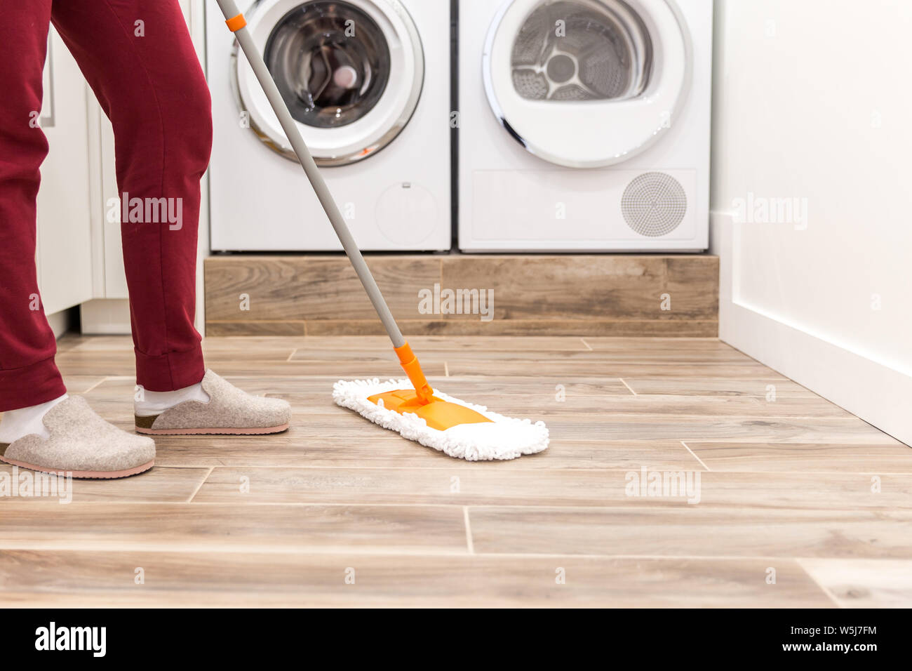 Cleaning Floor In Laundry Room In Modern House Stock Photo