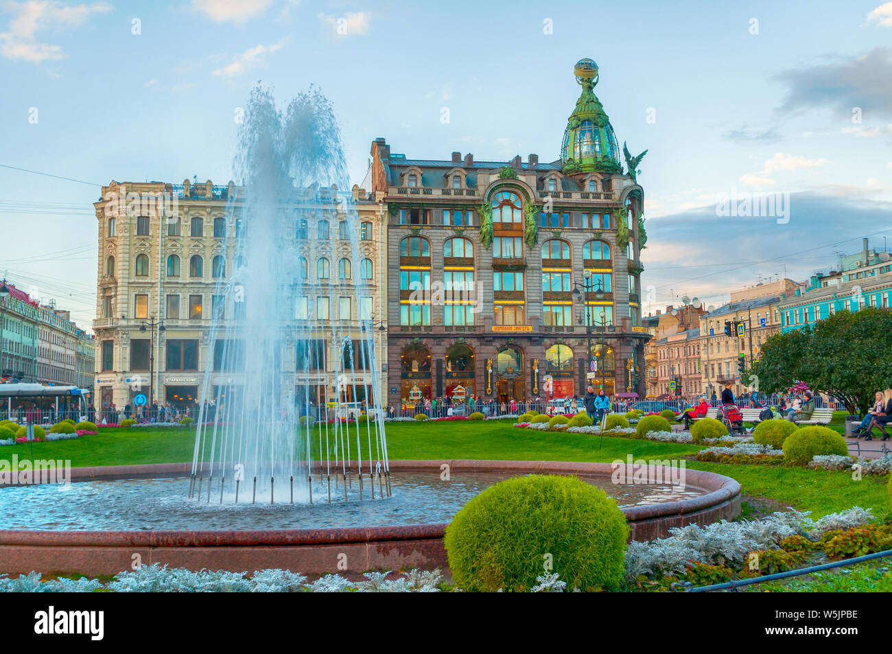 St Petersburg, Russia -October 3, 2016. Zinger House on Nevsky Prospect in the historic center of the city and fountain on the foreground. Autumn even Stock Photo