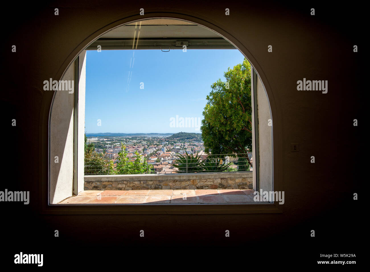 HYERES, FRANCE - JULY 28, 2019: View on the Mediterranean sea through a window of the villa Noailles, designed by the architect Mallet-Stevens, Hyeres Stock Photo