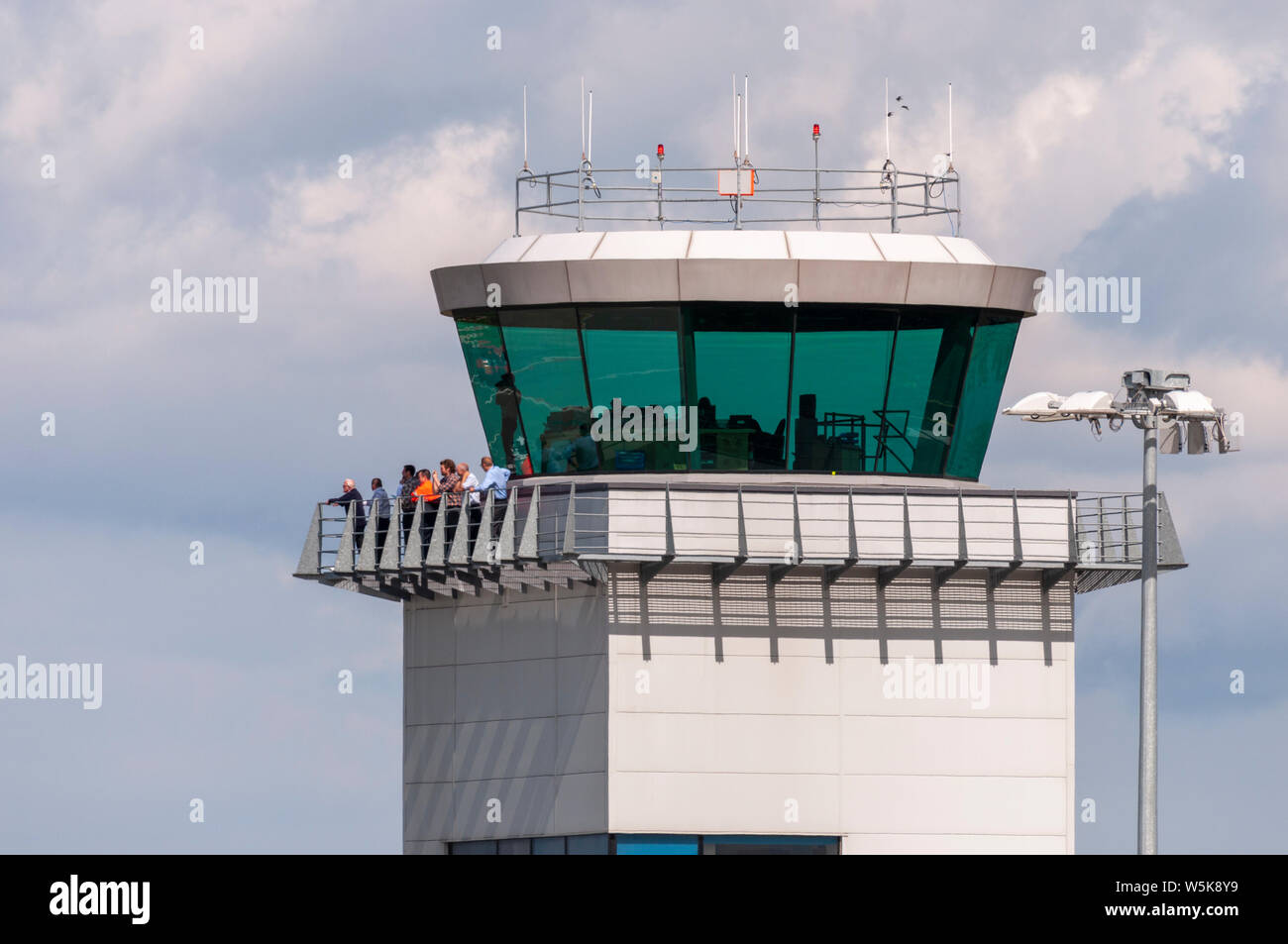 Air Traffic Control tower at London Southend Airport, Essex, UK, with staff on the balcony to witness the visit of an Avro Lancaster from Canada Stock Photo