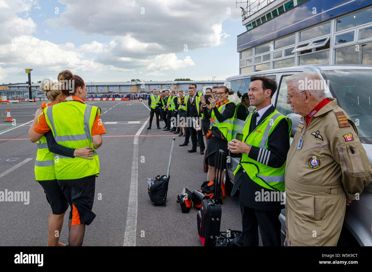 Canadian Warplane Heritage Museum Avro Lancaster bomber visited London Southend Airport, Essex, UK. easyJet airline crew watching with Don Schofield Stock Photo