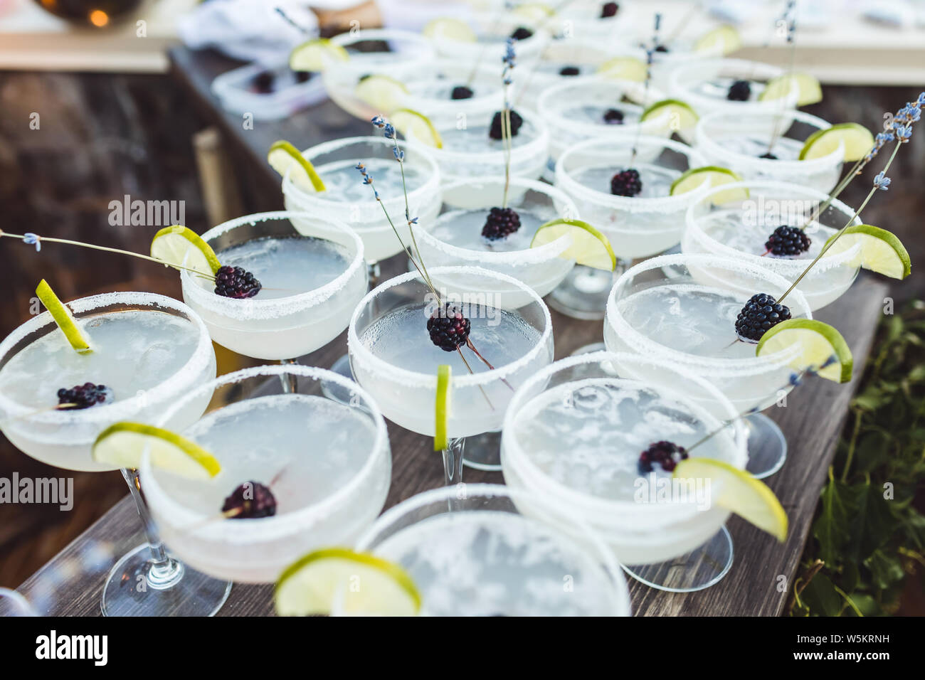 Set Of Margarita Cocktails With Slice Of Lime And Blackberry On Top On Bar Counter Evening Patry Wedding Reception Stock Photo Alamy