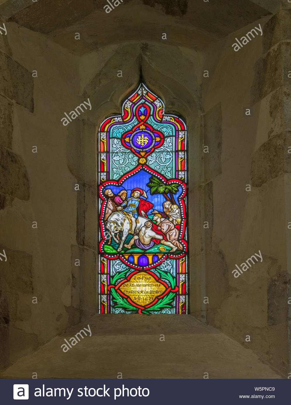 Interior of St. Mary's Church Hartley Wintney, Hampshire UK. Picture shows a stained glass window erected in memory of Charles Felix Palmer who died o Stock Photo