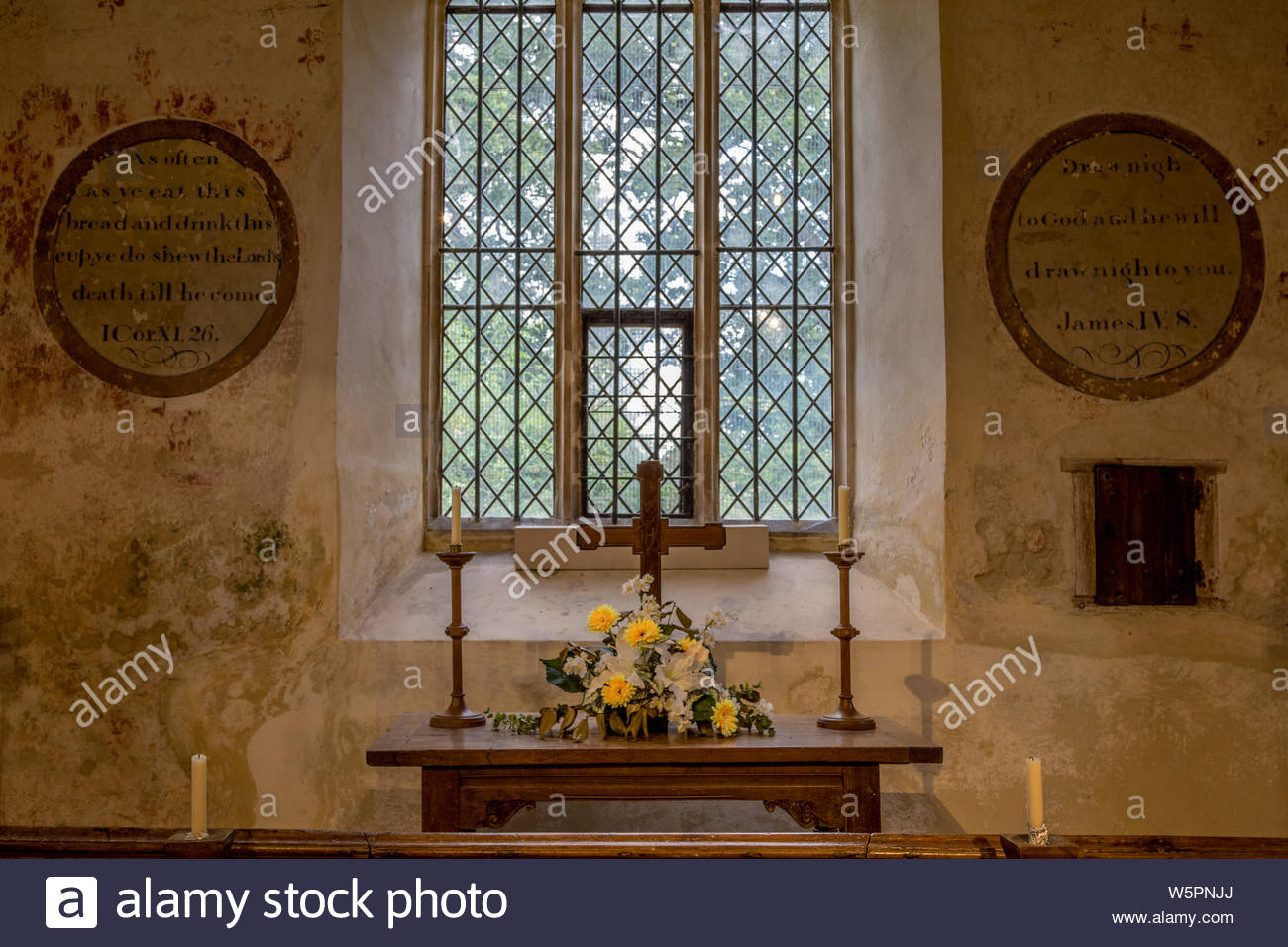Interior of St. Mary's Church Hartley Wintney, Hampshire UK. Picture shows the eastern window, altar and communion rail and wall painting remnants. Stock Photo
