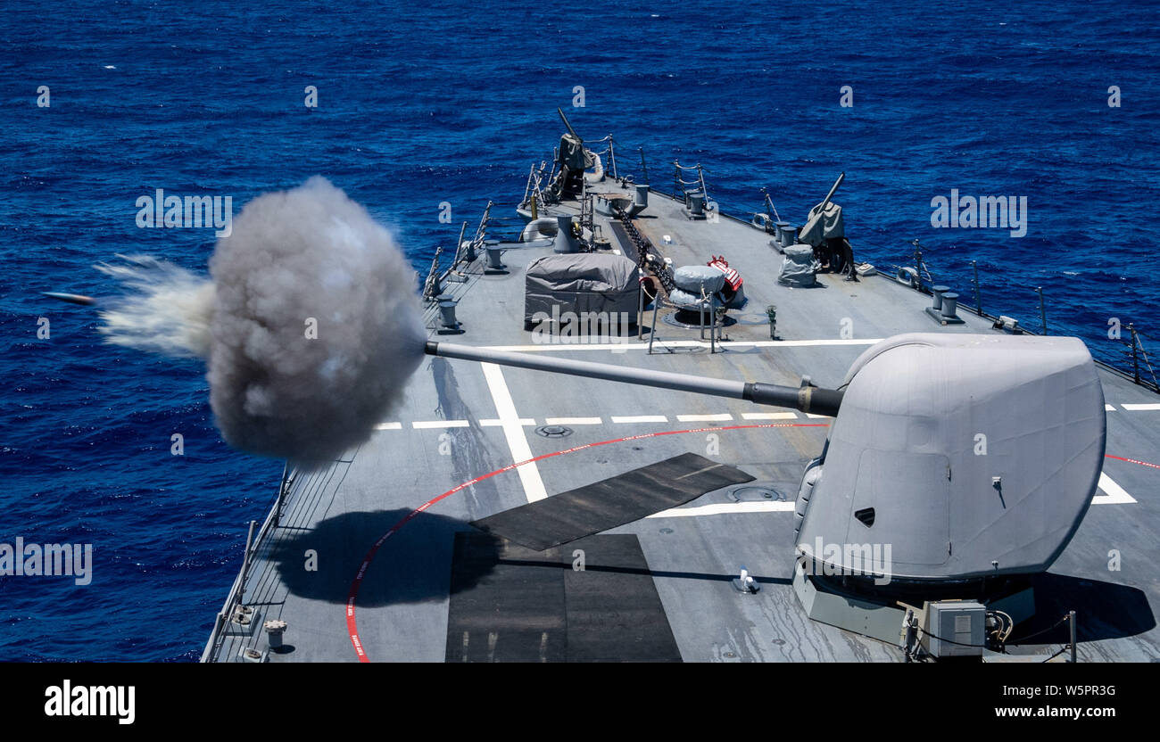 The Arleigh Burke-class guided-missile destroyer USS Porter (DDG 78) fires a Mark 45 5-inch gun during a live-fire exercise in the Atlantic Ocean, July 26, 2019. Porter, forward-deployed to Rota, Spain, is on its seventh patrol in the U.S. 6th Fleet area operations in support of U.S. national security interests in Europe and Africa. (U.S. Navy photo by Mass Communication Specialist 3rd Class T. Logan Keown) Stock Photo
