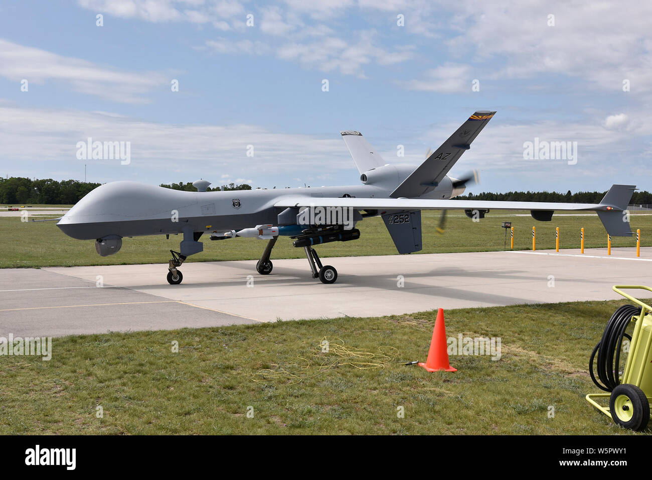 An MQ-9 Reaper assigned to the 214th Aircraft Maintenace Squadron performs preflight operations before taking off during Exercise Northern Strike at the Alpena Combat Readiness Training Center, Mich., July 22, 2019. Northern Strike 19 is a National Guard Bureau-sponsored exercise uniting approximately 5,700 service members and more than 20 states and seven coalition countries at the Camp Grayling Joint Maneuver Training Center and the Alpena CRTC, both located in Northern Michigan. (U.S. Air National Guard photo by Senior Airman Ryan Zeski) Stock Photo