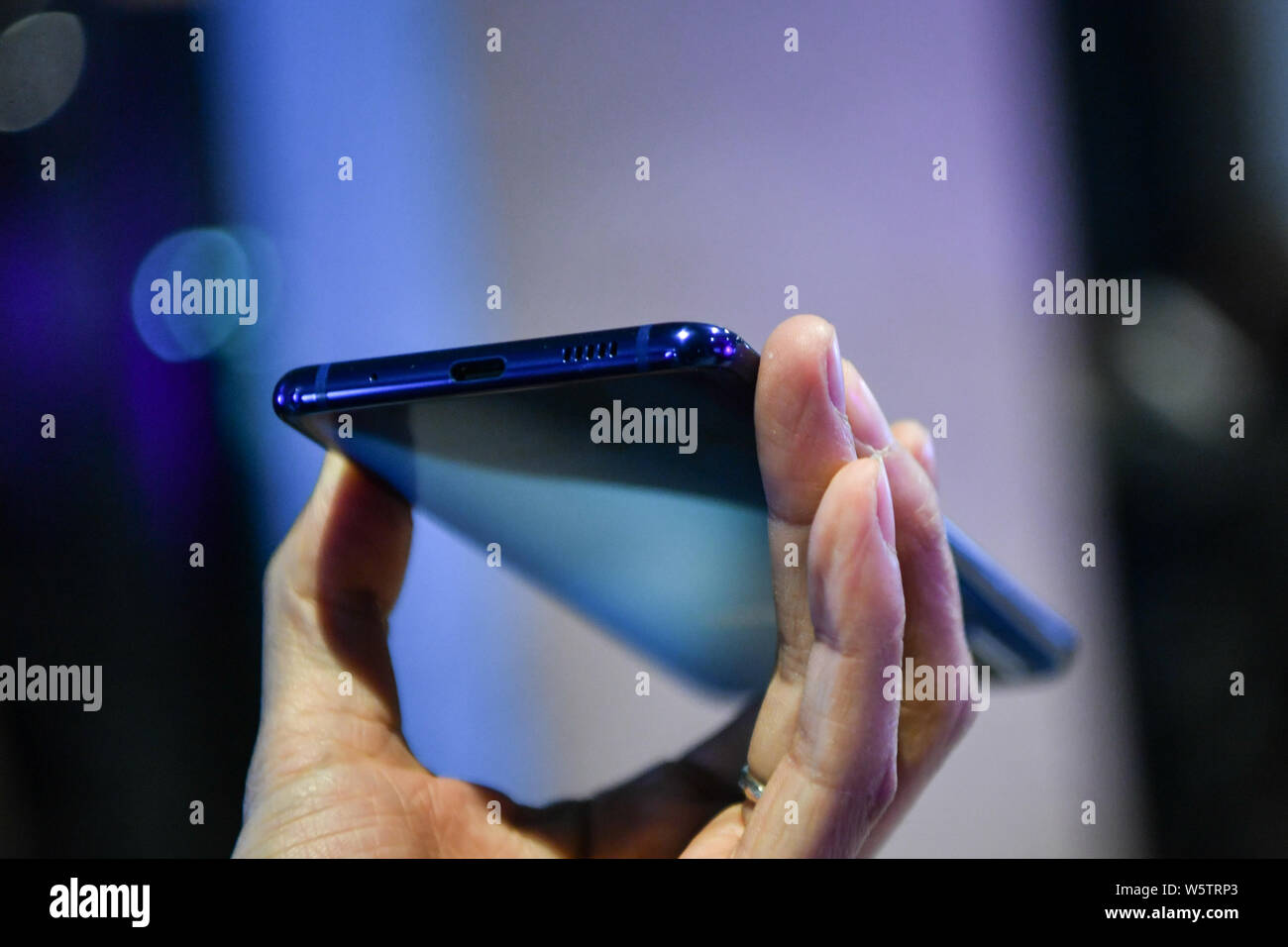 A customer tries out a Samsung Galaxy A8s smartphone during the launch event in Beijing, China, 10 December 2018.   Samsung announced its first Infini Stock Photo