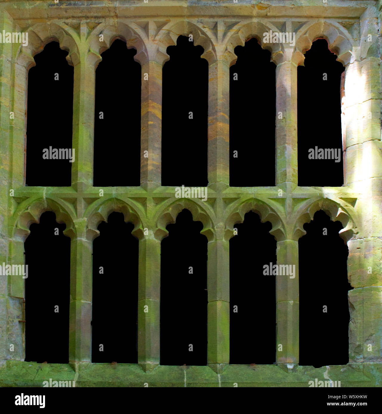 blacked out windows in gothic building Stock Photo