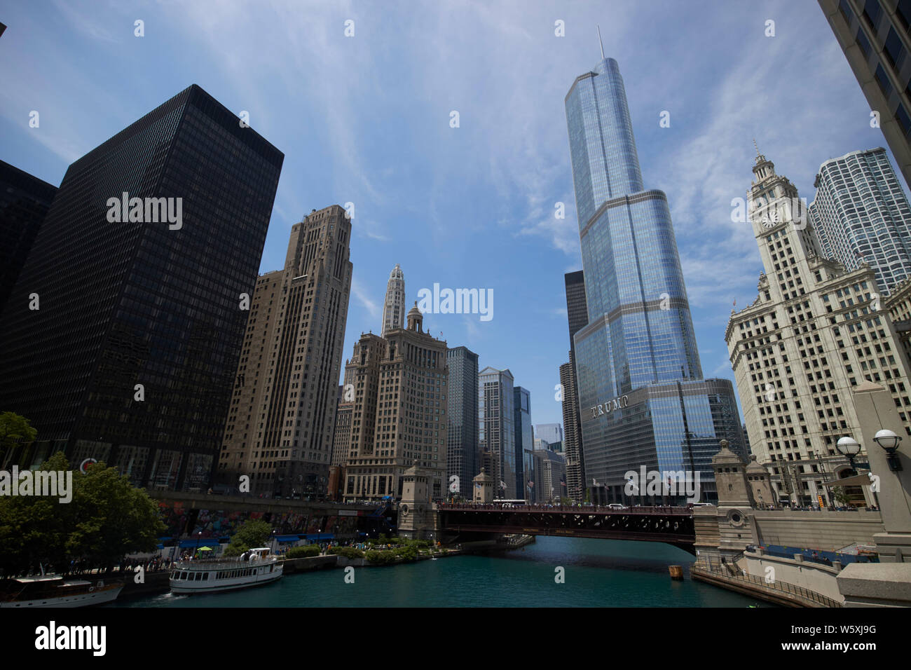 looking along the chicago river towards the michigan avenue dusable bridge and trump tower downtown Chicago IL USA Stock Photo