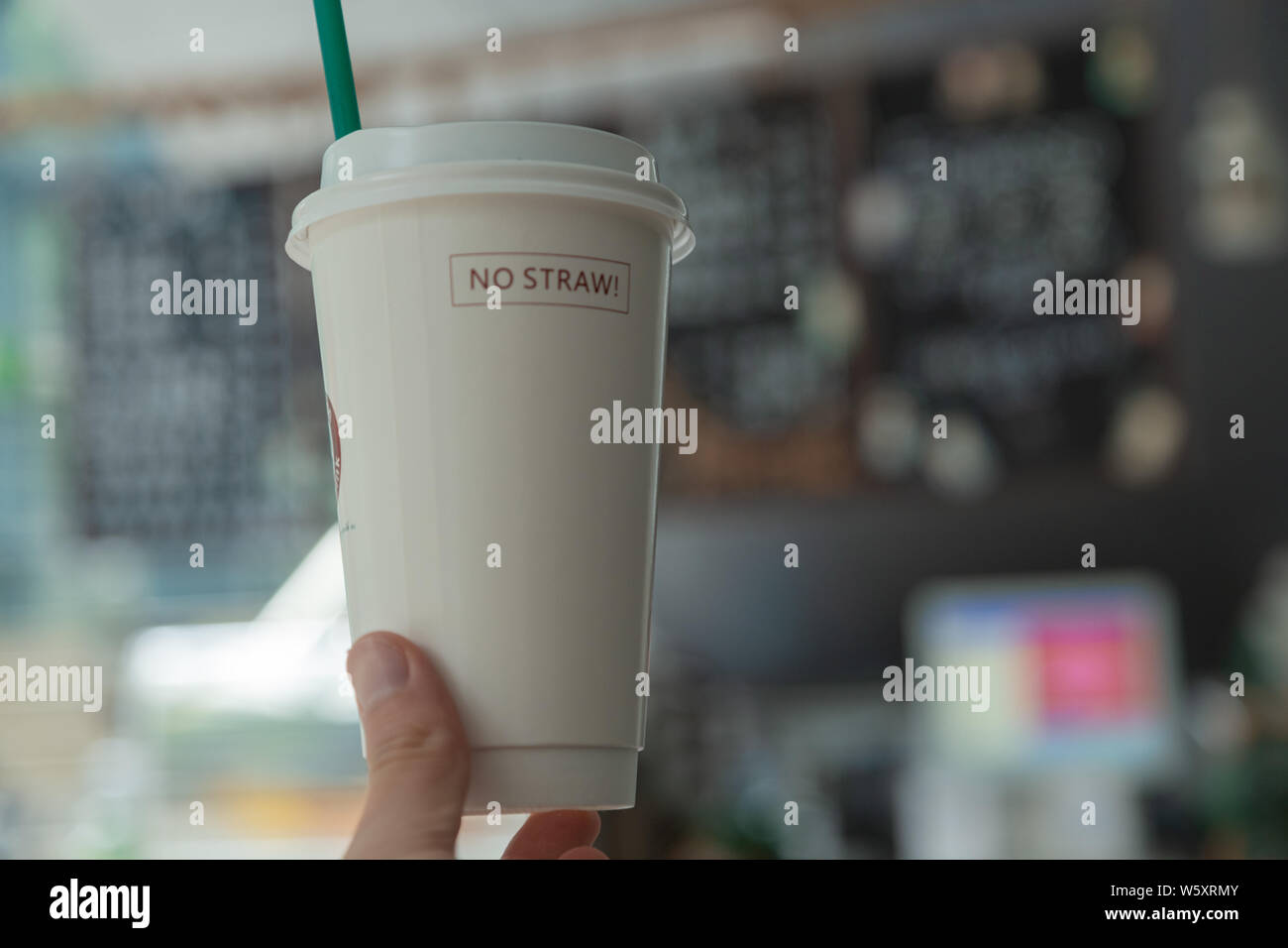 Summer Interior In The Coffee Shop Blurred Coffee Shop Background Coffee Cup In Hand Paper Drink Cups Paper Cups Yellow Straw Stock Photo Alamy