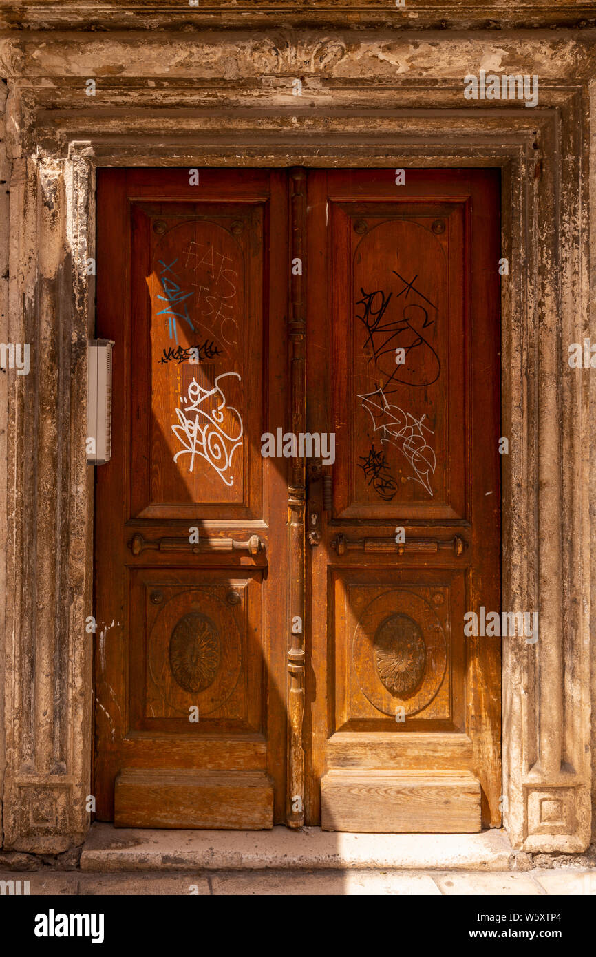 Old graffiti covered door in Spilt, Croatia Stock Photo