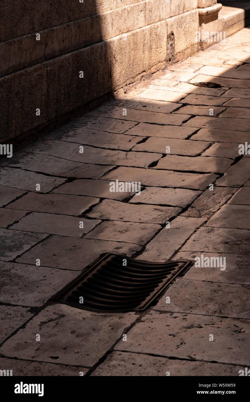 Old marble flagstone pavement in Split, Croatia Stock Photo