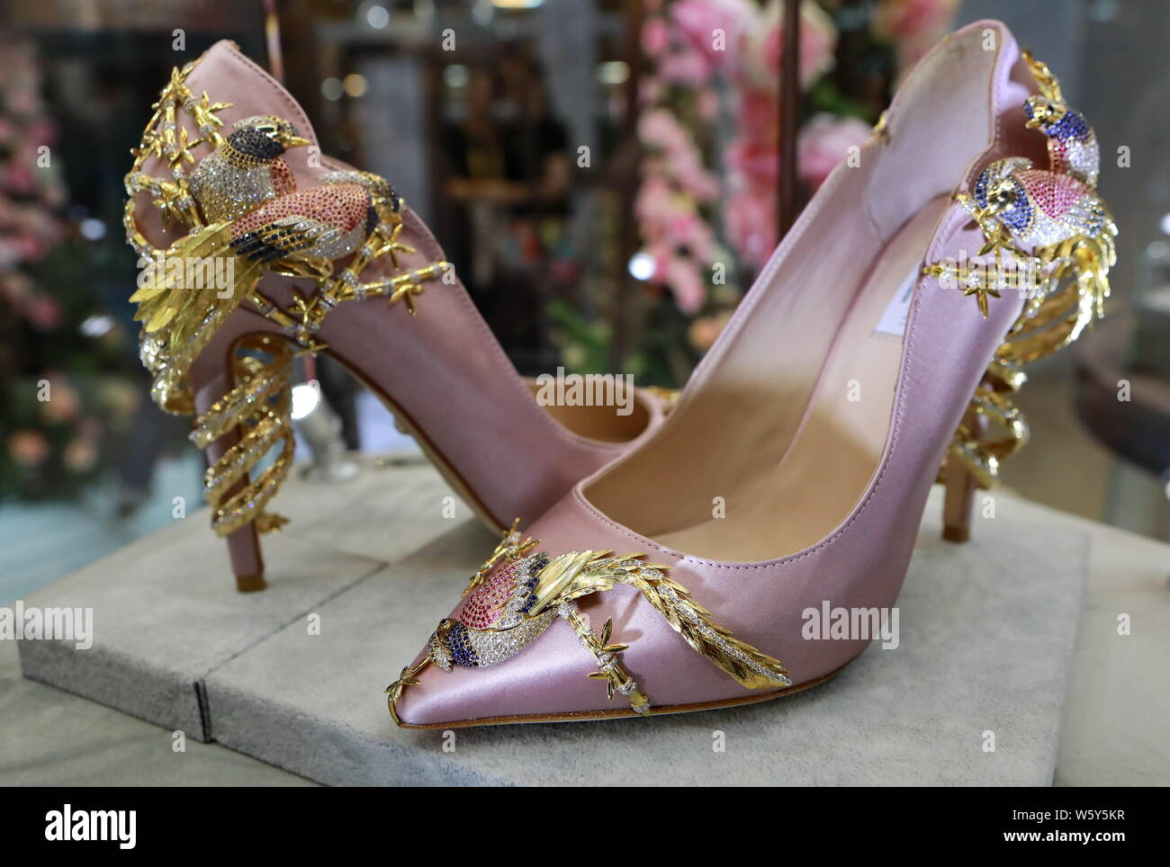 A pair of luxury high heel shoes is on