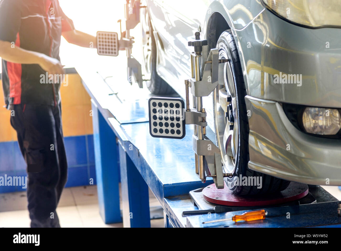 Car Wheel Alignment in tire garage service Stock Photo