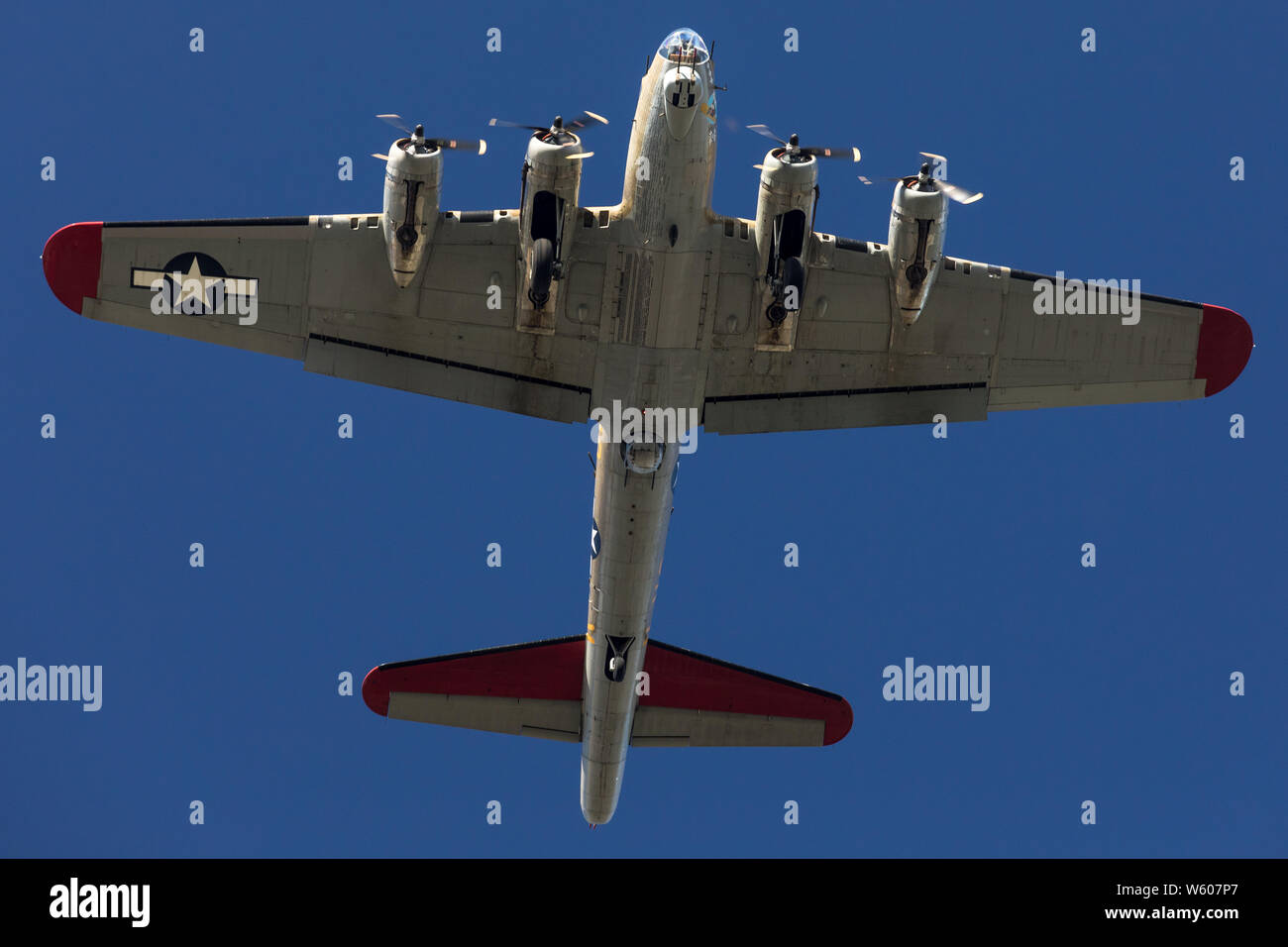 Low altitude pass of a Boeing B-17 Flying Fortress WWII bomber. Stock Photo
