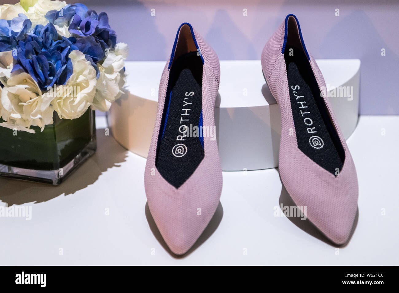 A pair of new shoes is displayed at the