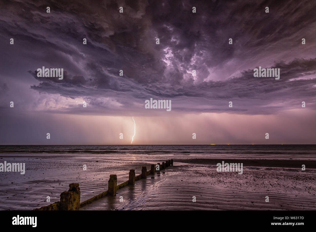Lightning strike at West Wittering Beach on Tuesday 23rd July 2019 under a very intense sky Stock Photo
