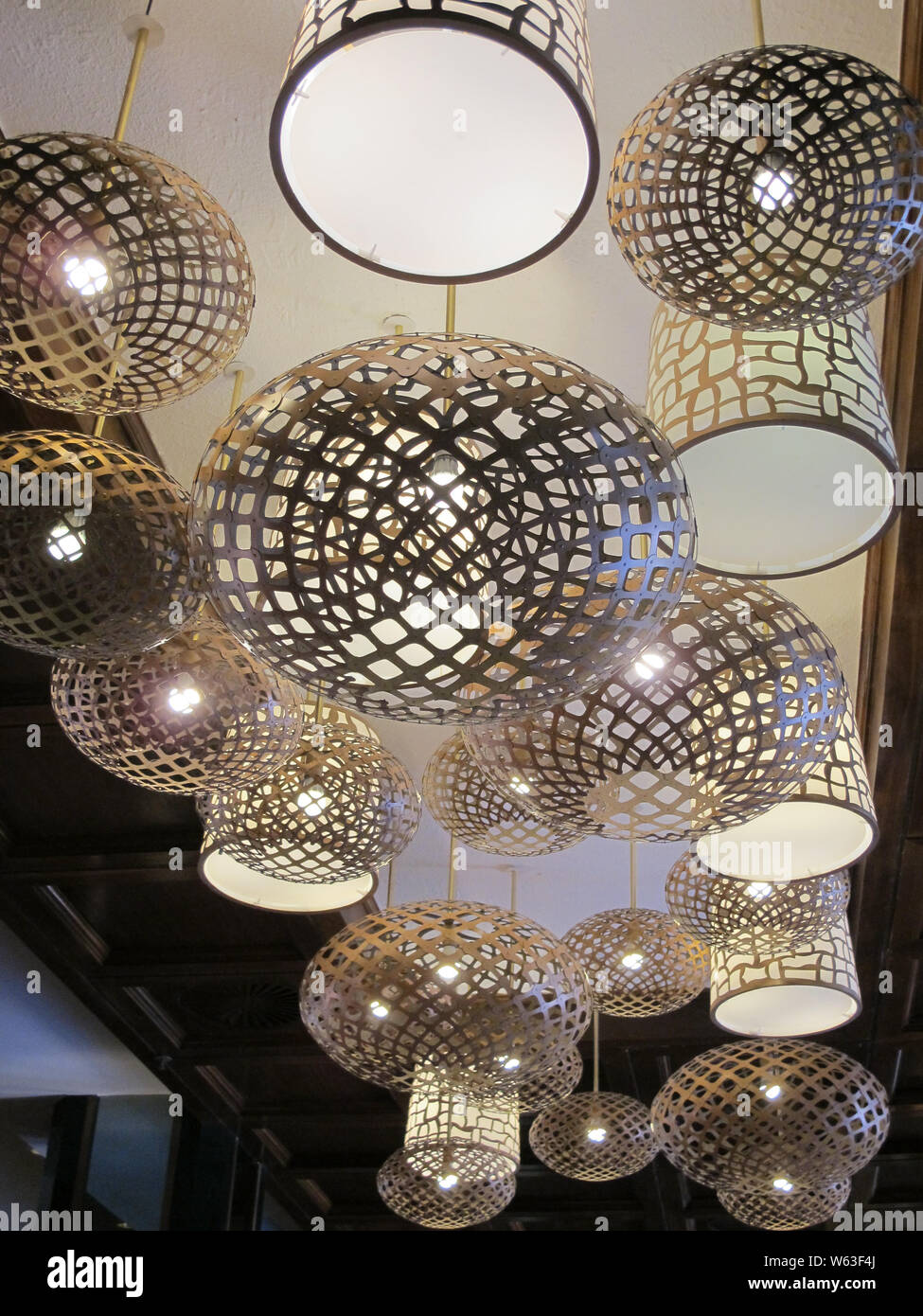 Shiny Silver Metallic Circular Lamp Shades Hanging From A White Ceiling In A Group Or Collection In A Very Modern Or Contemporary Design And Style Stock Photo Alamy