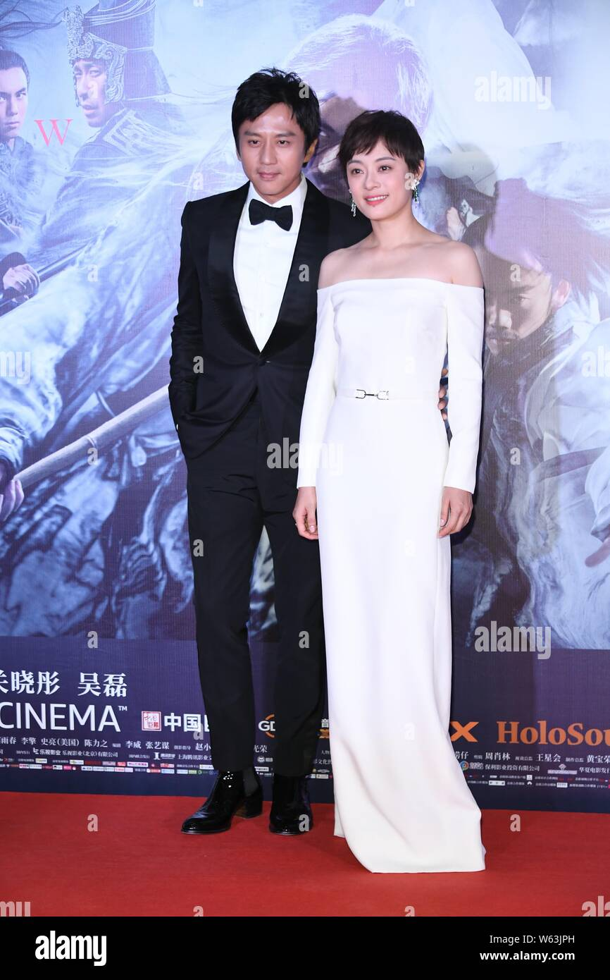 Chinese Actress Sun Li Right And Her Actor Husband Deng Chao Arrive On The Red Carpet For The Premiere Of The Movie Shadow In Beijing China 27 S Stock Photo Alamy