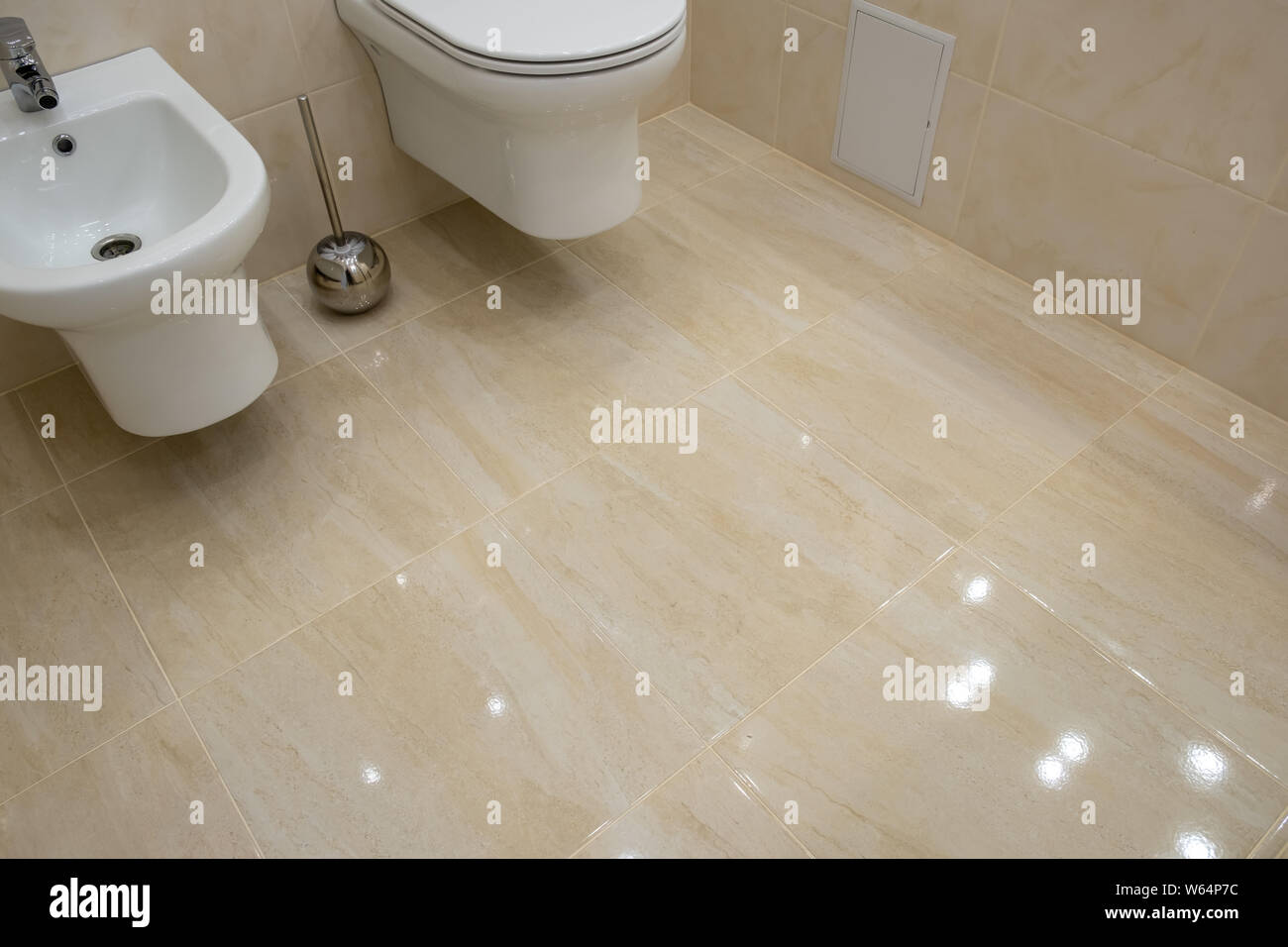 Brilliant Toilet And Bidet In A Modern Bathroom Raised Lid Light Caraccident5 Cool Chair Designs And Ideas Caraccident5Info