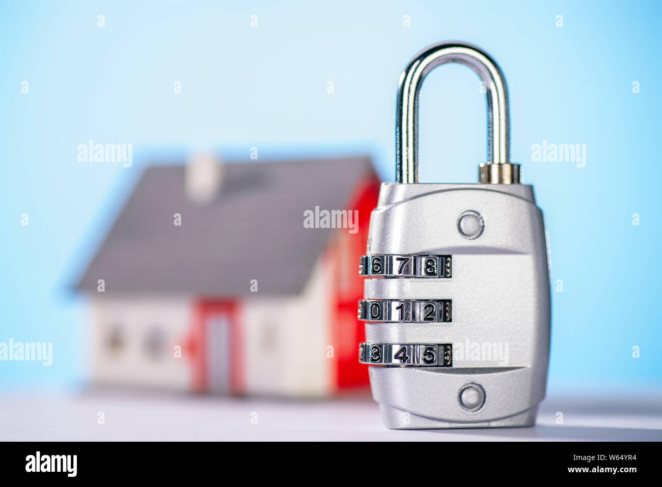 Combination lock with house in the background Stock Photo