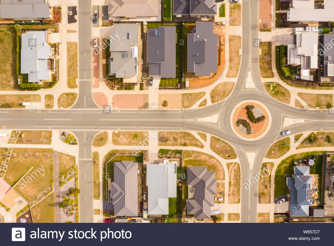 Aerial View Of Streets Rooftops And A Roundabout Embellished With