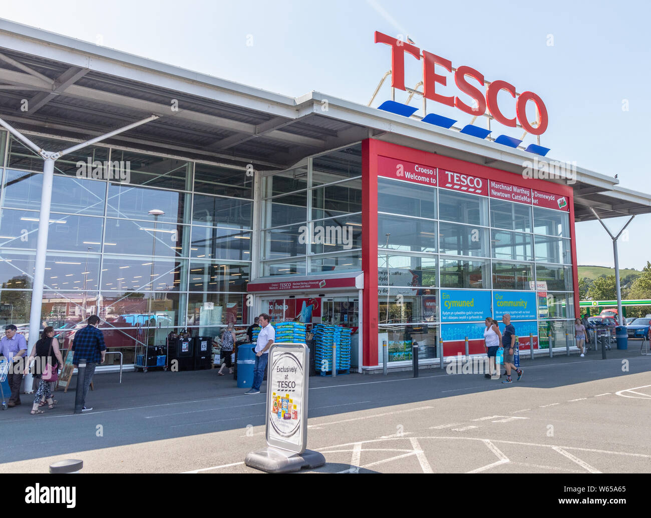 Newtown -  Wales / UK - July 23rd 2019 - Shoppers at Tesco supermarket entrance Stock Photo