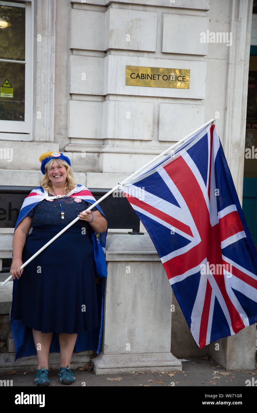 Stop Brexit supporter and remainer with flags protesting outside Cabinet Office on White Hall, London in July. Stock Photo