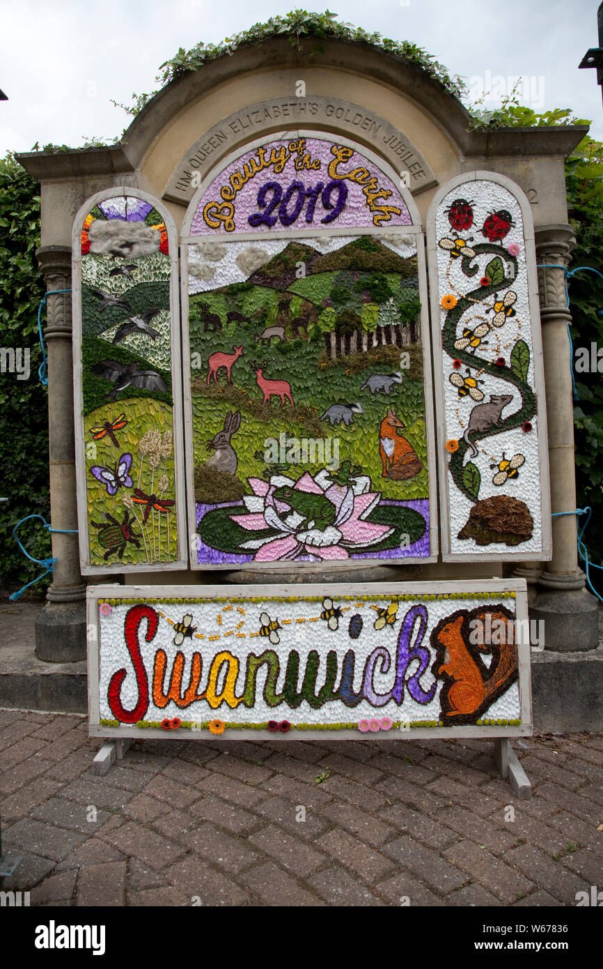 Well dressing in Swanwick - the art of decorating springs and wells with pictures made from natural materials, mainly flowers is an ancient custom fou Stock Photo