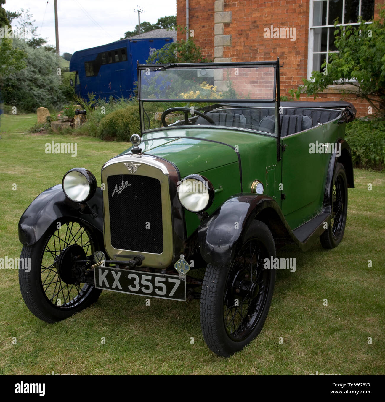 1929 green Austin Seven vintage Chummy parked on lawn, Mickleton Wood Farm, UK Stock Photo