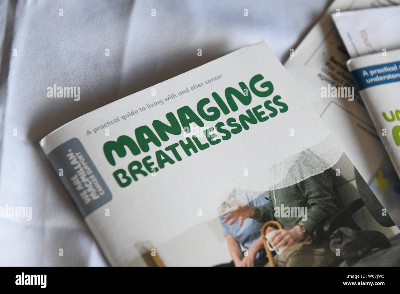 Pictured are leaflets by Macmillan Cancer Support about Mesothelioma. Stock Photo