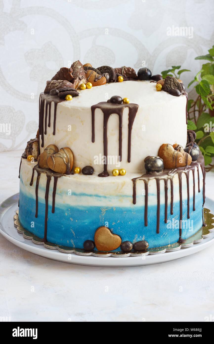 Sensational Tiered Birthday Cake On A Light Background Male Cake Stock Photo Funny Birthday Cards Online Alyptdamsfinfo