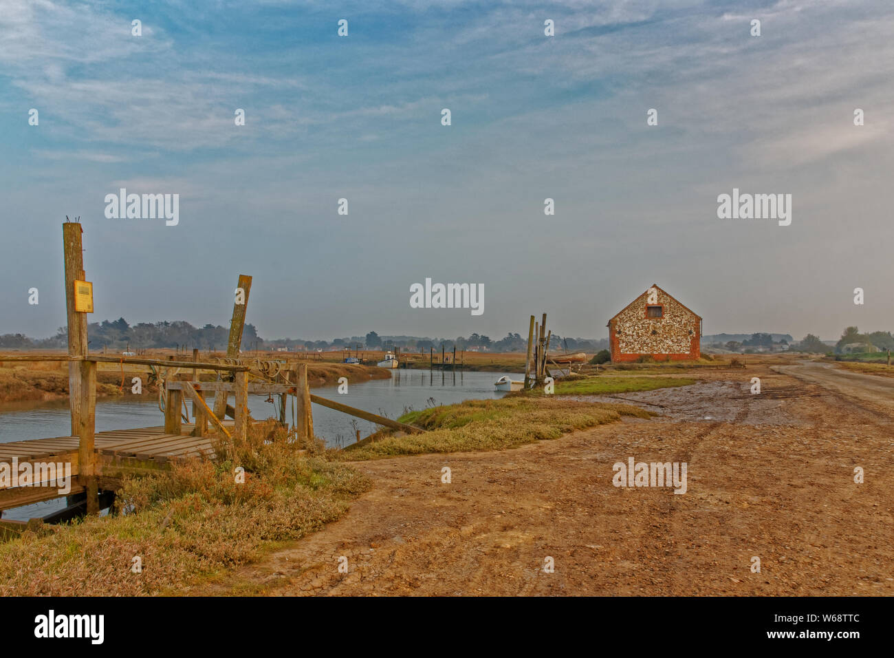 An old barn and jetties on the saltmarshes near Thornham in Norfolk Stock Photo
