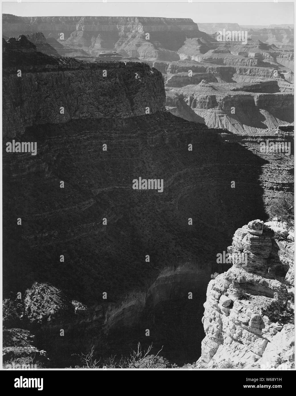 View of darkly shadowed canyon at left and center, from the South Rim, 1941, Grand Canyon National Park, Arizona. (vertical orientation), 1941 Stock Photo