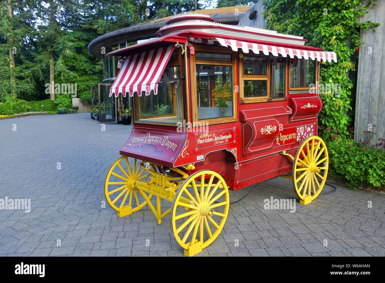 Antique Red Popcorn Wagon Restoration Model With Yellow Wooden Wheels Stock Photo