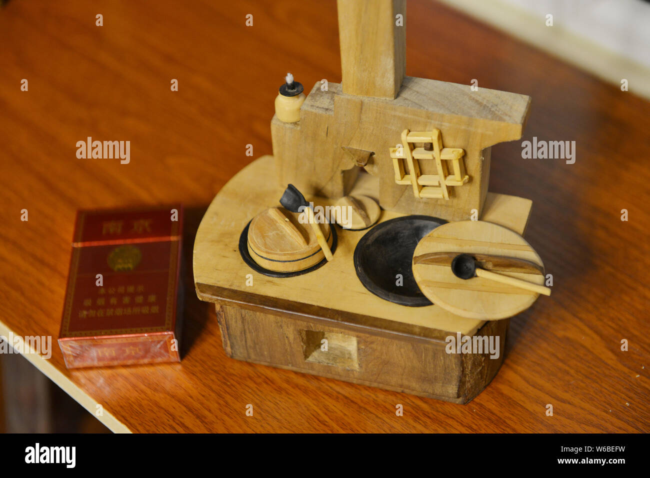 A Miniature Wooden Kitchen Stove Made By 69 Year Old Chinese