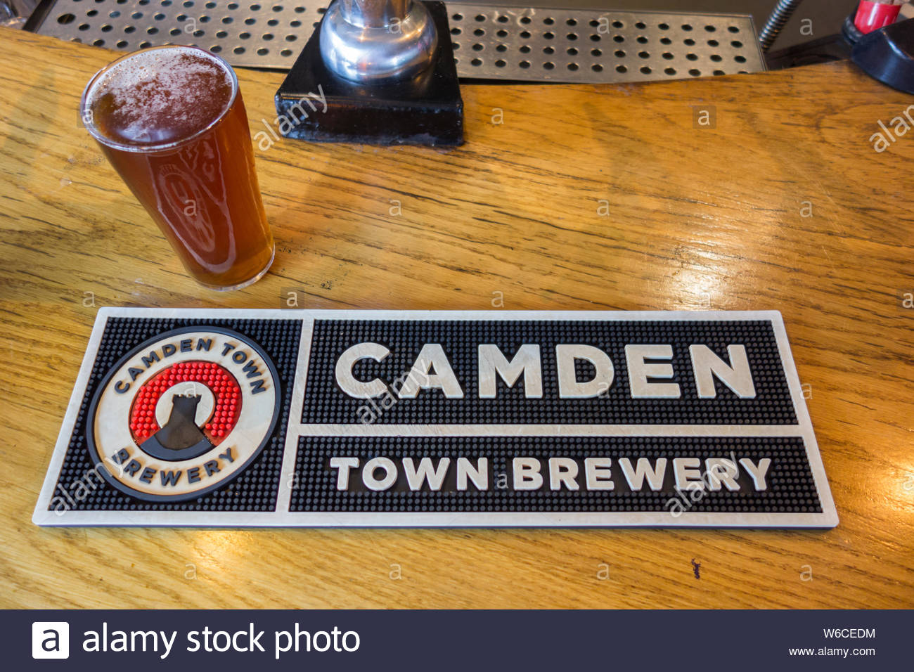 Camden Town Brewery beer mat on a pub counter, London, UK Stock Photo