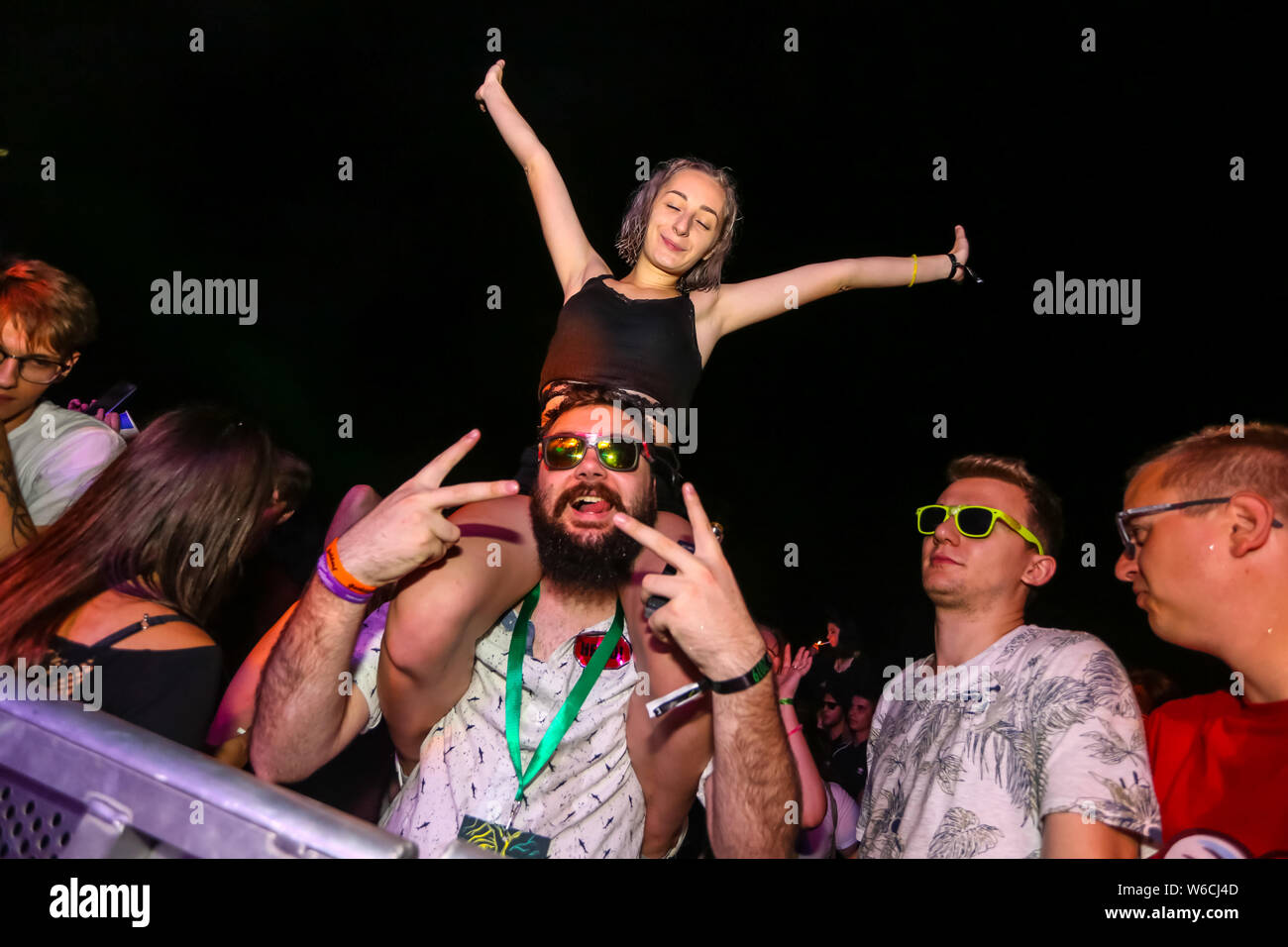 Brezje, Croatia - 19th July, 2019 : Audience during the Forestland, ultimate forest electronic music festival located in Brezje, Croatia. Stock Photo